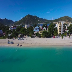4K aerial crabbing fly by of beach at Great Bay Town, St Maarten, Okt 2016 Stock Footage