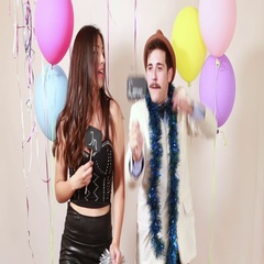 Slow motion of funny crazy couple in love having fun in photo booth Stock Footage