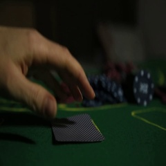 Casino table with poker player hands and playing card Stock Footage