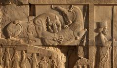 Bas Relief of Lion and Bull Fighting Beside an Achaemenid Soldier in Persepolis Stock Photos
