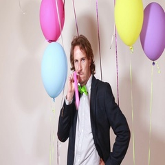 Attractive man blowing party horn Stock Footage