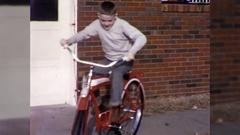 Boy Rides New Bike Merry Xmas Christmas Day1960s Vintage Film Home Movie 10536 Stock Footage