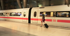 Young man with luggage get onboard to fast ICE train Stock Footage