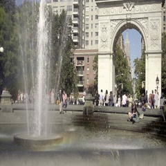 People hanging out summer Tisch Fountain arch and Empire State Building NYC Stock Footage