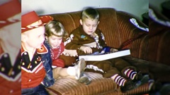 Children on Sofa Open Present Xmas Christmas 1960s Vintage Film Home Movie 10531 Stock Footage