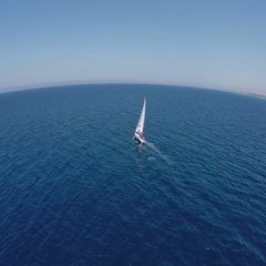 Sailing yachts with white sails in the open Sea. Drone view - birds eye angle Stock Footage