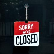 Closed sign in a shop window sorry we are closed Stock Photos