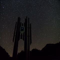 Stars rotate over national park symbol silhouette time lapse. Dolly shot Stock Footage