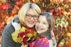 Mother and daughter in park autumn season Stock Photos