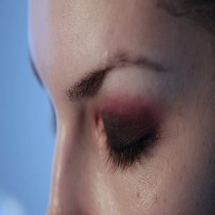 Woman blinking with her eye. Closeup video Stock Footage