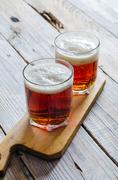 Two glasses of dark amber beer Stock Photos