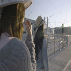 Young Women Walk On Bridge Together, They Decide To Race, Woman Runs Ahead Stock Footage