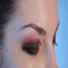 Closeup of applying makeup to the eye. Professional and accurate artist. Stock Footage