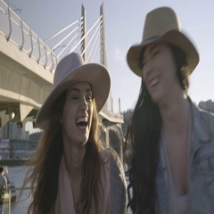 Young Women Walking Together Around Waterfront Esplanade, Talk And Laugh Stock Footage