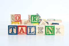 "The word ""talent"" spelled with wooden letter cubes Stock Photos"