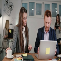 Two colleagues using digital display. Creative business small team meeting in Stock Footage