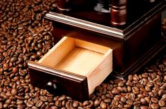 Coffee grinder with beans Stock Photos