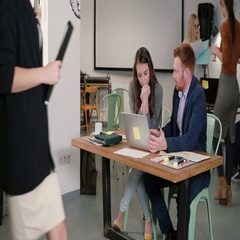Female leader giving direction to workers. Creative business team meeting in Stock Footage