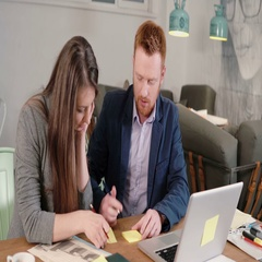 Two colleagues take notes discussing new ideas. Creative business small team Stock Footage