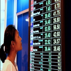 Woman watch currency exchange rate on board Stock Footage