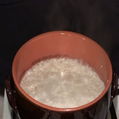 Rice boiling in a clay pot Stock Footage