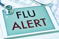 Text flu alert in a tablet computer Stock Photos