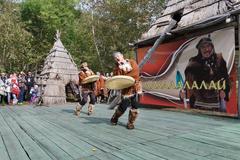 Dance ensemble ethnic dance with tambourines in clothing aborigine of Kamchatka Kuvituskuvat