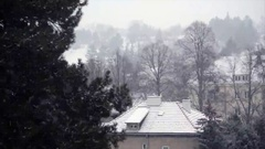 Snowy scene. White cityscape with old building around xmas time. Stock Footage