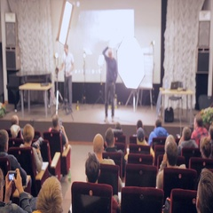 Business presentation seminar event in auditorium. Unerecognizable audience Stock Footage