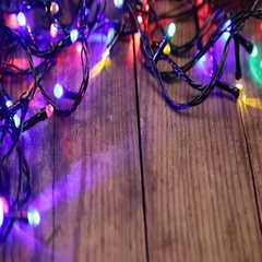Christmas lights on wooden background Stock Footage