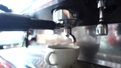 Black coffee from espresso machine (americano), slow motion Stock Footage