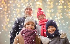 Happy family over christmas lights and snow Stock Photos