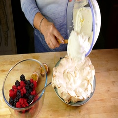Whipped cream being added to a baked meringue base. Stock Footage