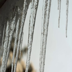 Icicles hanging on house roof Stock Footage