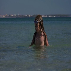 Little girl playing in the sea, swimming and diving Stock Footage