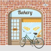 Bakery shop building facade of red brick .  Piirros