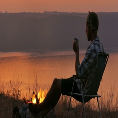 4K. Harmony of traveler .Tourist waiting sunrise near lake.   Stock Footage