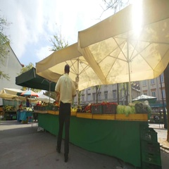 Man is looking around to see what fruits and vegetables to pick at the market Stock Footage