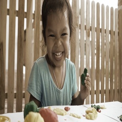 Slow motion of fun little girl with play clay for kids, vintage style Stock Footage