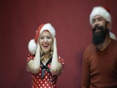 Couple is joking in Santa's Hats Stock Footage