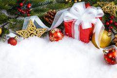 Christmas red gift with branch firtree and decoration Stock Photos