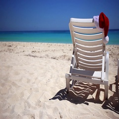 Santa Claus Hat on sunbed near  tropical calm beach Stock Footage