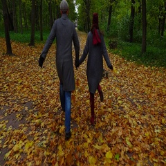 Couple run along dim autumn park alley, hold hands, yellow leaves on ground Stock Footage