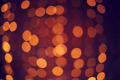 Defocused abstract red christmas background. Bokeh lights Stock Photos