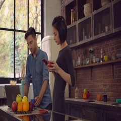 Two people holding cups and use gadgets indoors Stock Footage