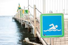 Diving allowed sign on a pier Stock Photos