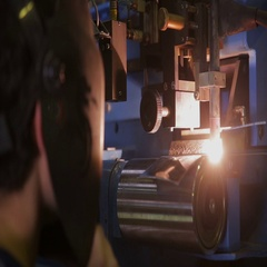 Arc welding workshop. Worker welding metal parts Stock Footage