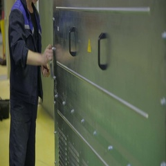 Worker screwing bolts, tightening the screws using screwdriver Stock Footage