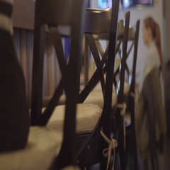 Girl in a black dress sitting on a bar stool Stock Footage