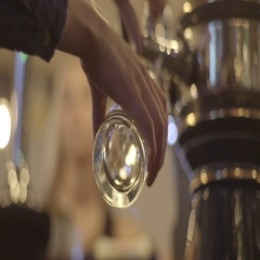 Woman pours beer into a glass Stock Footage